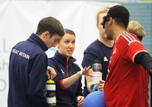 GB men coach Faye Dale and assistant Alex Bunney talking to players during a game