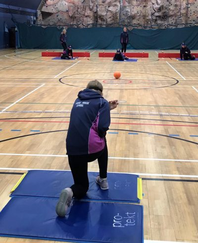 Action shot from Goalball UK School session in London, taken from behind the players