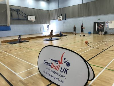 Action shot taken at school transition event, with Goalball UK banner in goreground