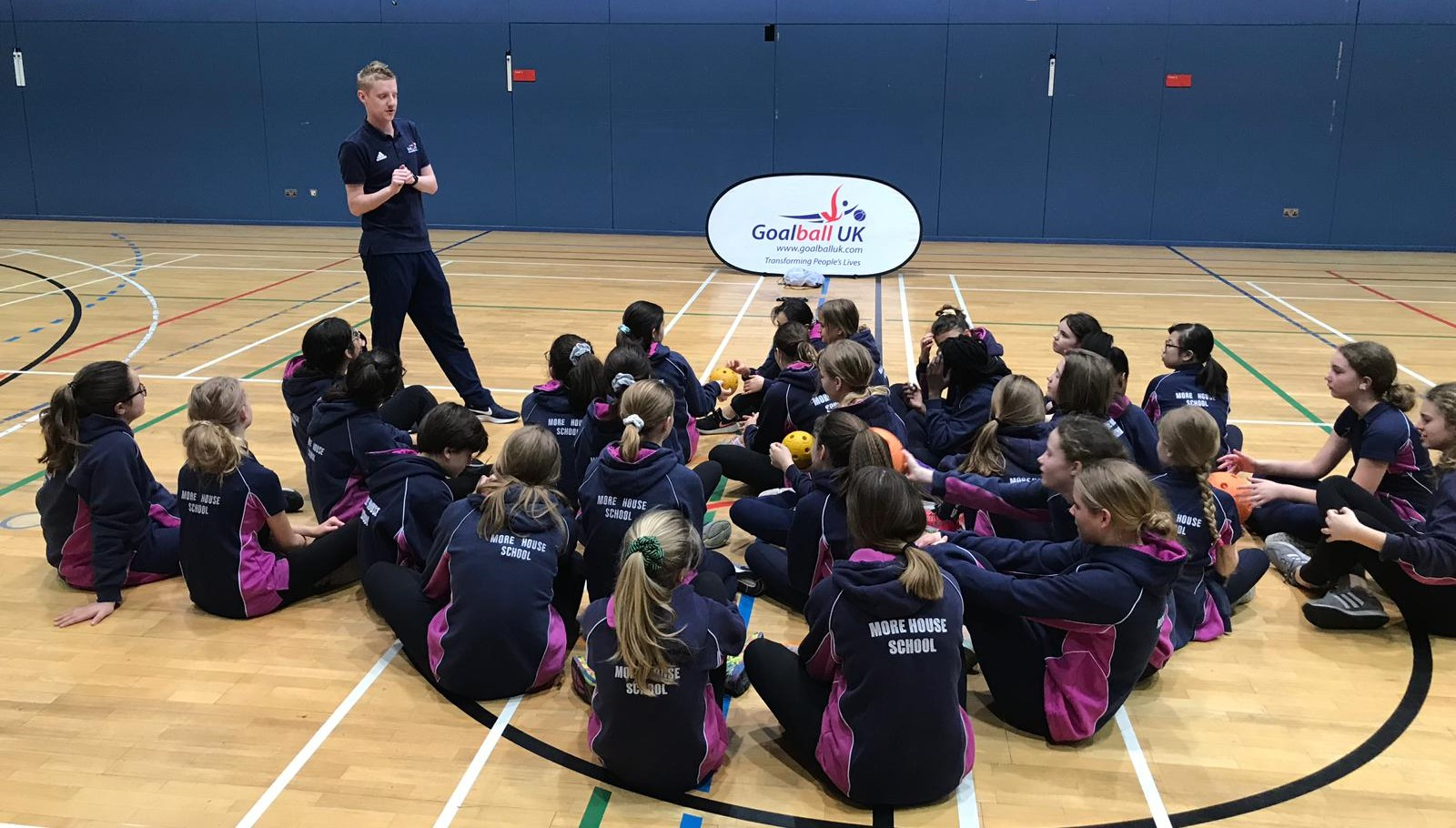 Group of school students listening to National Schools Officer, Stephen Newey, during school session