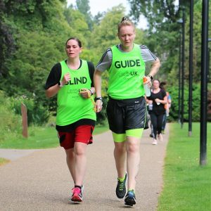 Gemma Bell (from West Yorkshire Goalball Club) being guided by Jenna Couch at Walsall parkrun