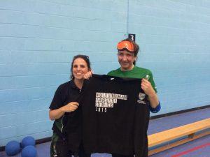 Sarah and Hannah smiling, holding a Nottingham varsity shirt
