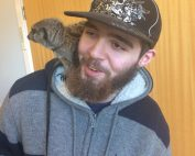 Picture of Danny, with a meerkat on his shoulder.