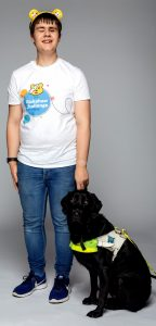 Kelsey, and guide dog Lacey, in a promotional image for BBC Children in Need's Rickshaw Challenge