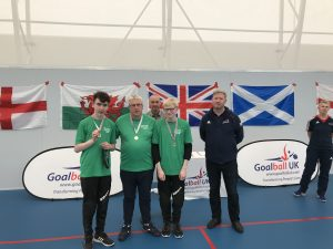 The Northern Ireland Goalball team, including James, collecting their medals at the 2018 Home Nations Tournament