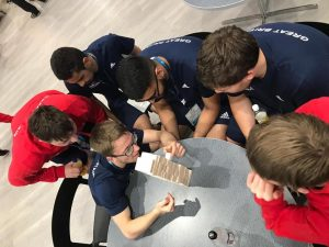 Naqib, and the rest of the Great Britain squad, playing a game of Jenga during some down time