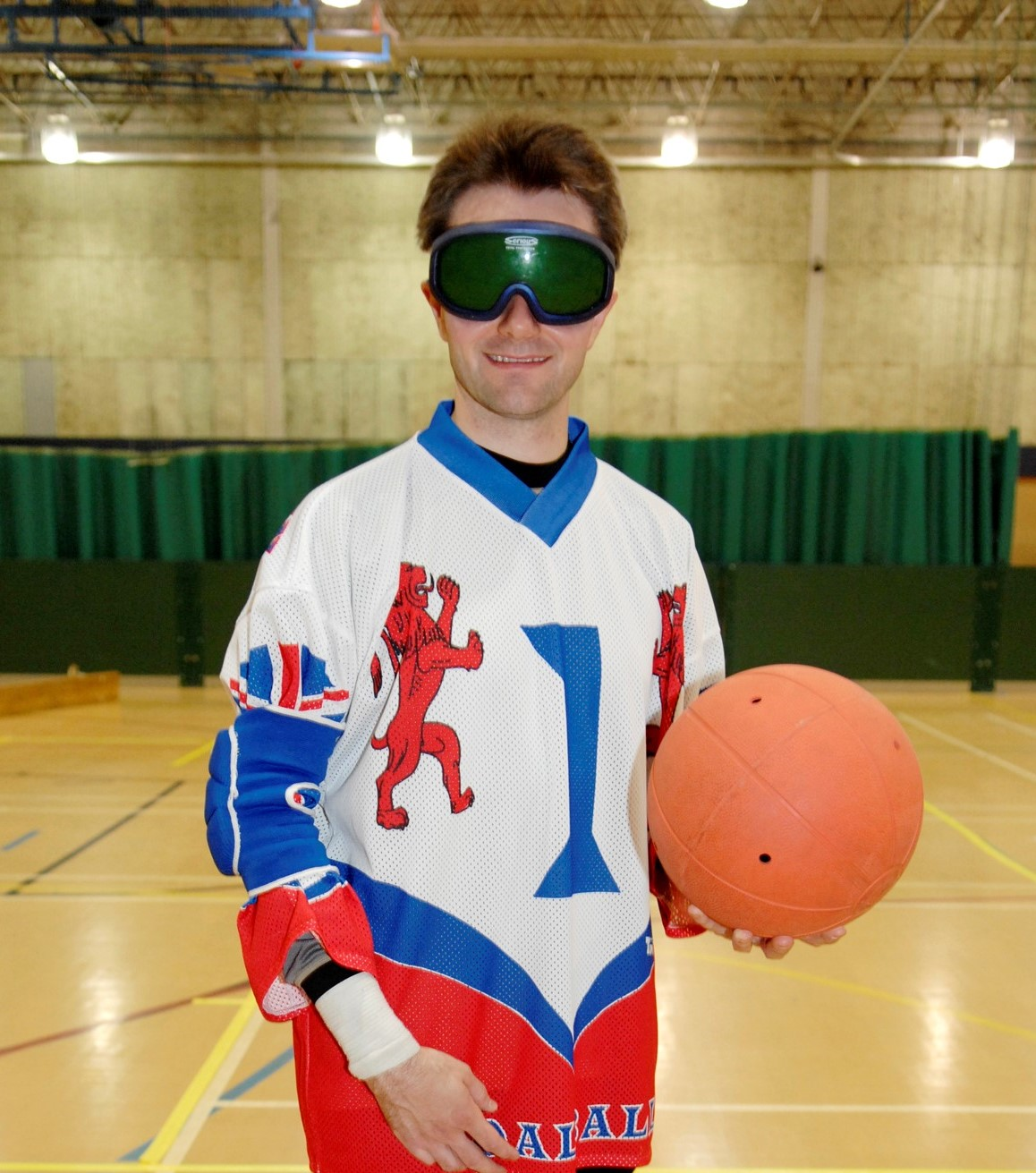 Former GB player James Risdon stood holding a goalball