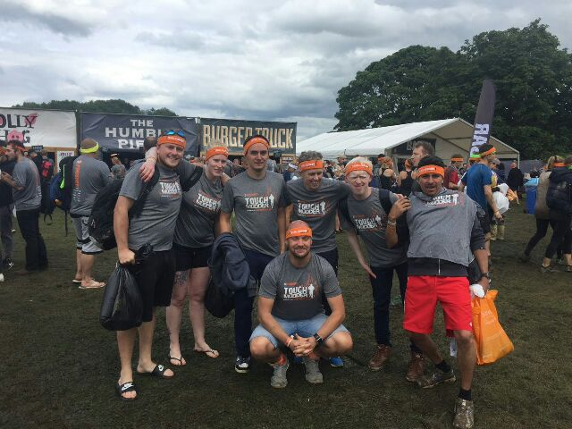 The Tough-Mudder participants stood together for a photo before the race