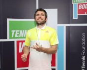 Image shows Roy smiling after receiving a tennis award