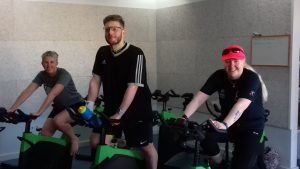 Paul on an exercise bike training for a triathlon