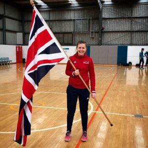 Becky smiling holding the Union Flag