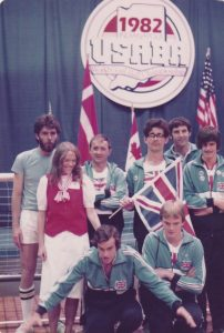 Image shows the GB Men's team at the 1982 world championships in the USA holding a Union Jack