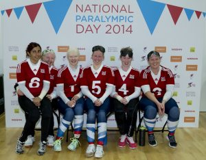 Image is of Team GB goalball players at the 2014 National Paralympic Day celebration