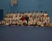 Image shows Megan with a group with her martial arts group