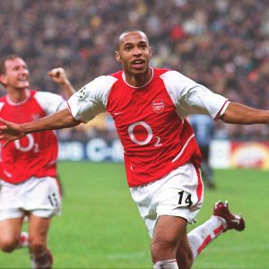 An iconic image of Thierry Henry celebrating after scoring a goal for Arsenal.