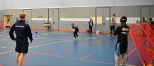 Goalball UK National Talent Camp 2019. This image shows Tom Dobson looking onto a goalball game.