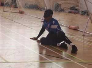 Devante Claridge in the goalball ready position mid match.