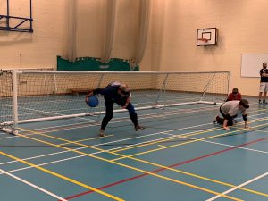 John Grosvenor throwing a goalball (under eye-shades!).