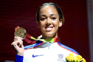 Katarina Johnson Thompson posing with a gold medal.