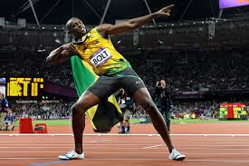 Usain Bolt doing his signature bolt pose after a race at the London 2012 Olympics.
