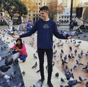 Dan Willoughby feeding pigeons in a city square. Very inspirational!