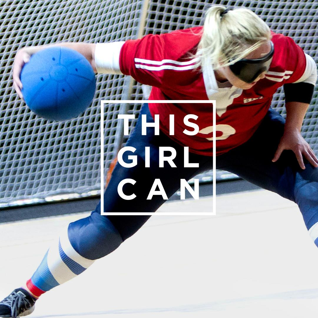 This girl can advertisement. It shows a female goalball player just about to shoot with the this girl can logo in front of her.