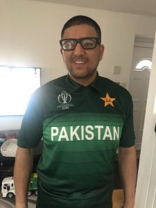Abu-bakr Ishtiaq posing in his Pakistan Cricket shirt.