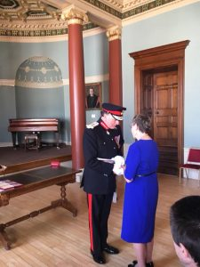 Dina Murdie receiving her British Empire Medal.