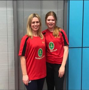 Kerry and Connie O'Brien standing together for a photo at a North region tournament in Sheffield.