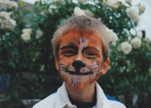 Dom Roper with Tiger faceprint as a youngster. It was meant to be at Fen Tigers!