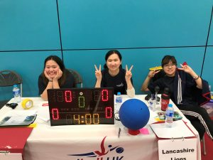 Sheffield North region tournament. This image features table officials posing with smiley faces before a goalball game.