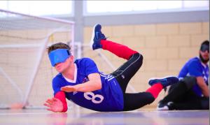 Joe Roper saving a shot wearing blue Goalfix eyeshades!