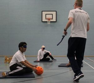 Stephen Newey, Goalball UK's Children & Young People's Officer coaching goalball to school pupils.