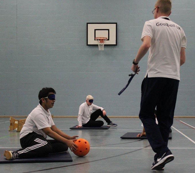 Stephen Newey, Goalball UK's Children & Young People's Officer coaching goalball to school pupils.