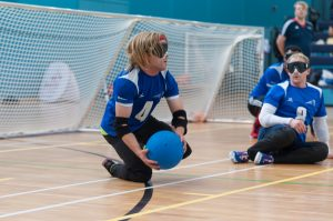Warren Wilson mid Goalball game just standing up and about to throw.