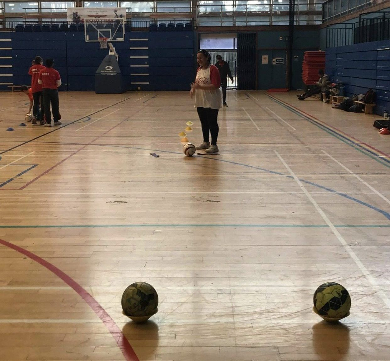 Action shot of Alex playing goalball!