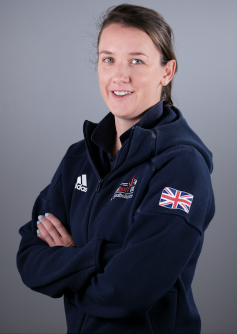 Image shows Faye stood smiling at the camera in her GB jacket with her arms crossed