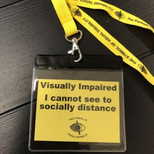"A lanyard that says ""Visually Impaired - I cannot see to socially distance."
