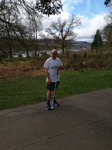 Graeme stood in the park wearing a Goalball UK t-shirt
