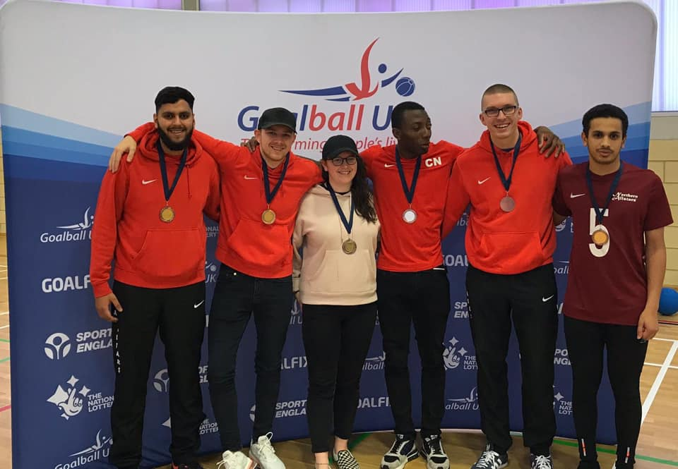 Image shows Matt stood with his Northern Allstars teammates following a tournament in 2019. They are all proudly wearing their medals