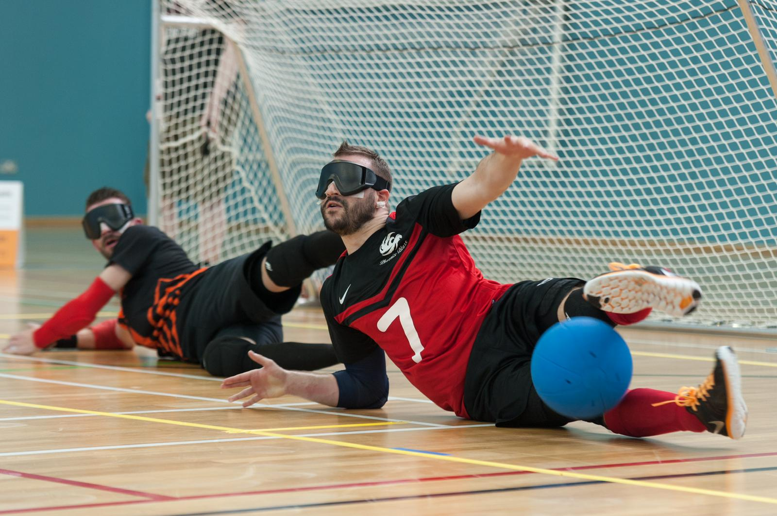 Dave Butler action shot, diving to save a shot