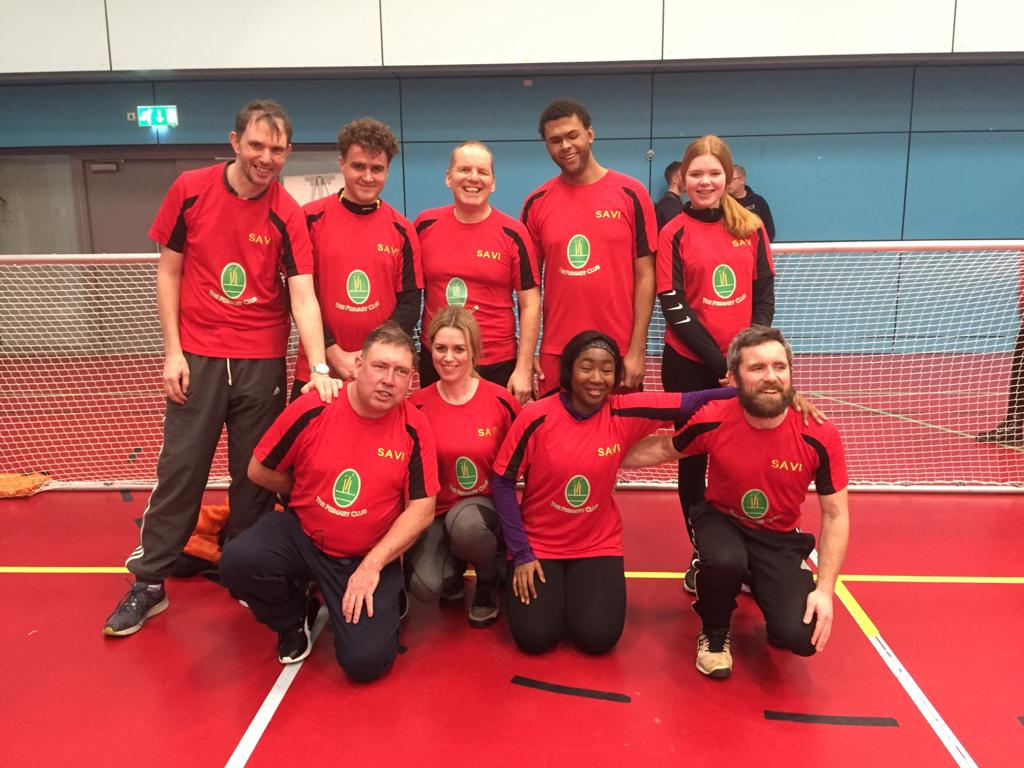 Image shows Matt Cliff stood with his Mersey Sharks teammates at the EIS in Sheffield