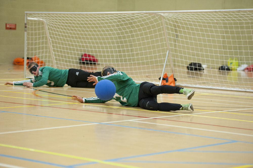 Image of a Goalball player blocking