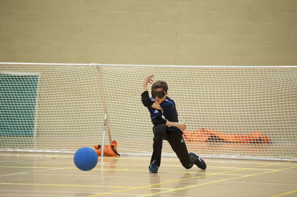 Image of a Goalball player in front of goal