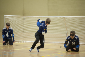 Image of a Goalball player on the attack