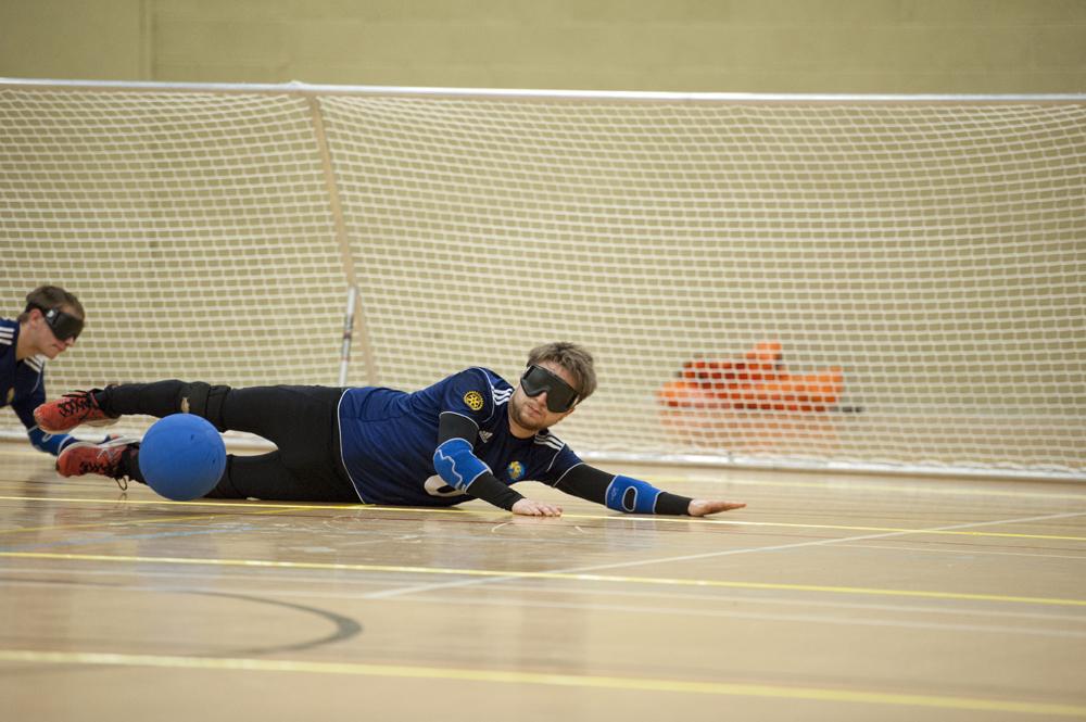 Goalball player defending the goal