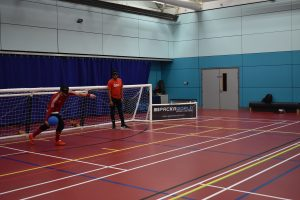 Dan Roper lining up to take a shot, against the inflatable goals