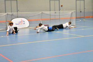 Action shot of a team defending a shot towards centre