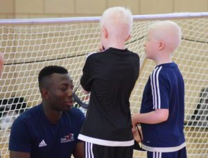 GB player Caleb Nanevie coaching and advising young players