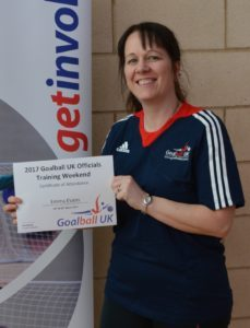 Emma Evans smiling and sporting her Goalball UK Officiating certificate